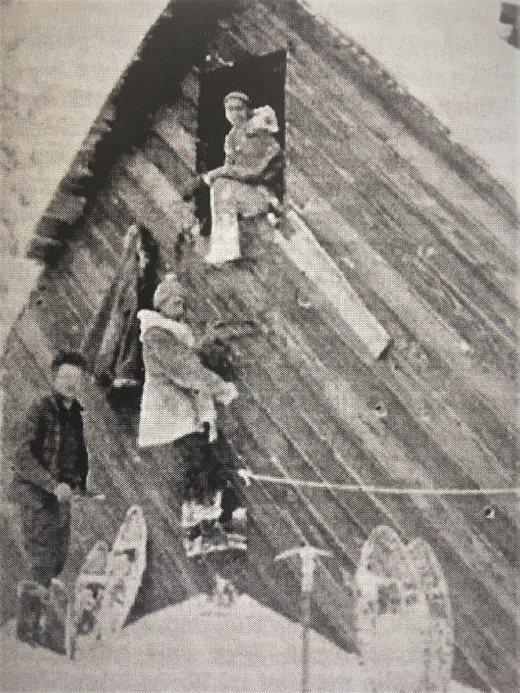 Text Box: Timberline Cabin as it appeared in 1932. Note the door and ladder on the second story. This design made access easier in winter when snow depth could be 20' or more. Here members of the Wy'east Climbers are entering the cabin. Curtis Ijames is in the door, James Mount on the ladder and Walt Staehli on the snow. Today nothing is left of Camp Blossom, Camp George, the Timberline Cabin or the Timberline Hotel. A sign on the Timberline Trail just west of the Timberline Lodge marks the historic location.