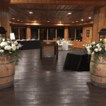 Two Barrels with white flowers as the entrance to the Timber Room