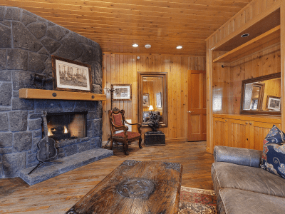 Grooms Room with Stone Fireplace & Leather Couch