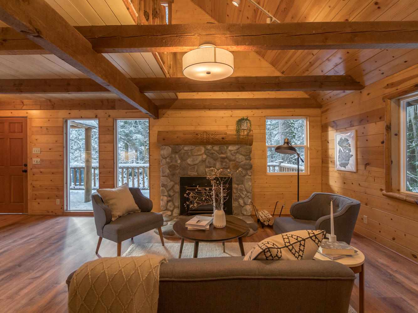 Ski cabin with stone fireplace and open wood beams